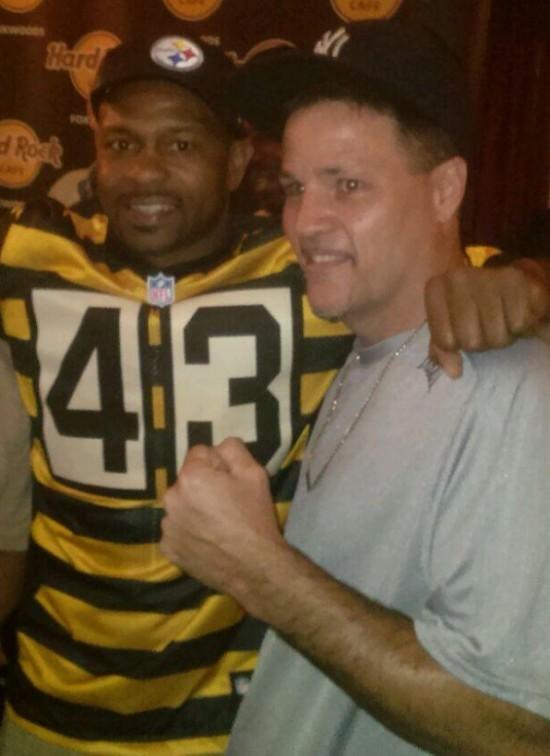 Roy Jones, Jr., at left, mugs with John Scully.