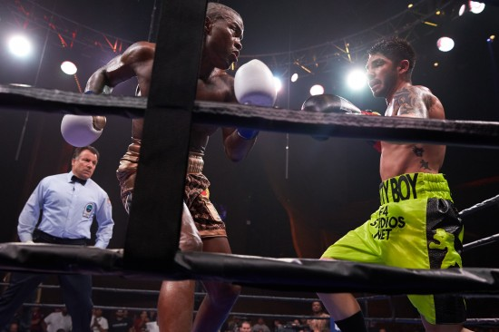 Quillin, at left, and Zarafa slug it out as referee Arthur Mercante, Jr. looks on.