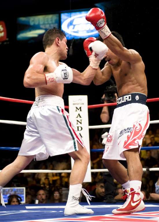 Former WBC Lightweight Champion, David Diaz, seen here at left versus Manny Paquiao, will be among those honored at the Illinois Boxing Hall of Fame Banquet on November 14th (photo by Tom Barnes-TOMBA Images).
