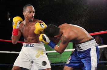 Louis Cruz (L) Puts the finishing touches on Ariel Vazquez- Photo by Ed Diller/DiBella Entertainment)