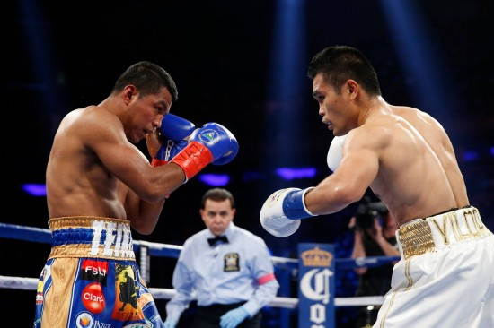 Roman 'Chocolatito' Gonzalez, at left, and Brian Viloria engage (photo by Will Hart/HBO Boxing)
