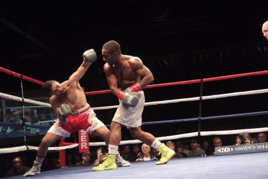 Johnson, at right, attacks Gavronski en route to his stoppage win.