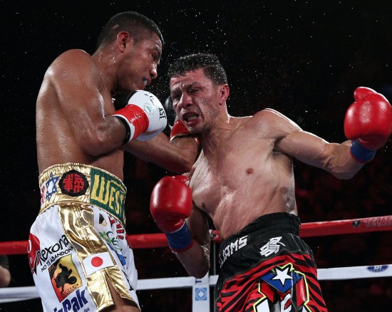Gonzalez, at left, and Arroyo mix it up (photo by Chris Farina-K2 Promotions)