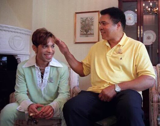 Muhammad Ali, at right, with the late pop music icon, Prince.