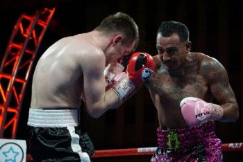 Hernandez (R) takes it to Magomedov - Photo by Manny Murillo / RJJ Boxing Promotions