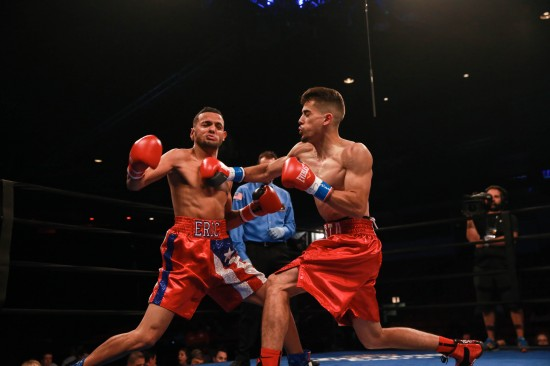 Hernandez, at right, drills Gotay with a vicious right.