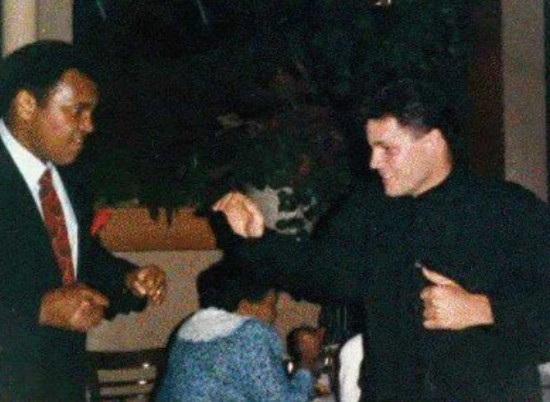 Muhammad Ali, at left, shadow boxes John Scully (photo courtesy of John Scully).