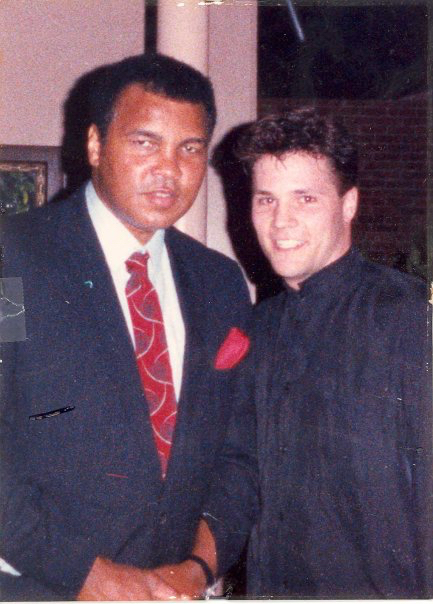 The late Muhammad Ali, at left, shakes hands with a young John Scully (photo courtesy of John Scully)