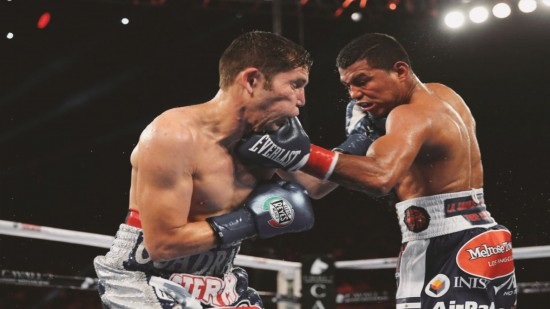 Gonzalez , at right, lands a left hook to the chin of Cuadras (photo courtesy of K2 Promotions).