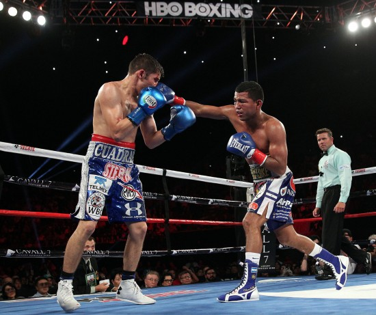 Gonzalez, at right, lands the right on Cuadras.