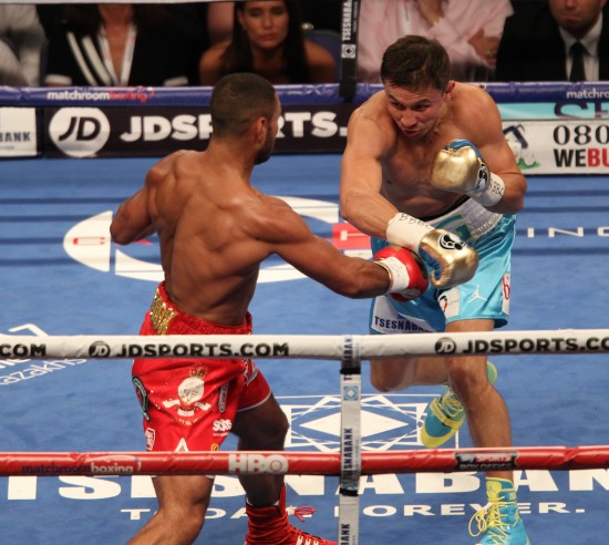 Golovkin (right) and Brooks slug it out along the ropes.