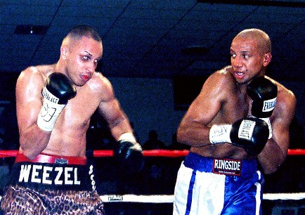 David Estrada, at left, in another win versus Kenny Gould (photo by Jorge Bravo).