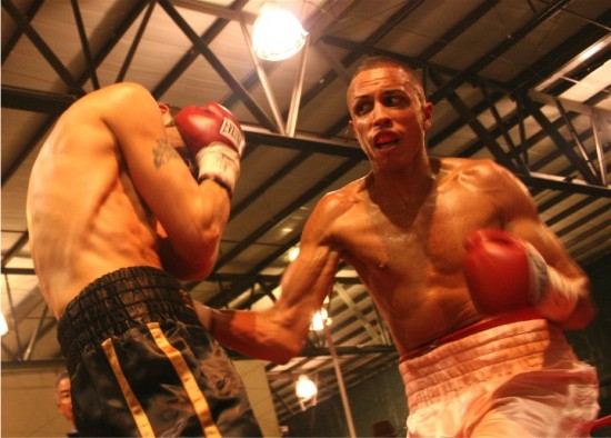 David Estrada rips the body of Bruce Rumbolz en route to stopping him inside six rounds in November 2007 (photo by Juan C. Ayllon)