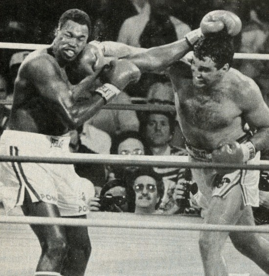 Cooney lands a ponderous right to the jaw of Larry Holmes.