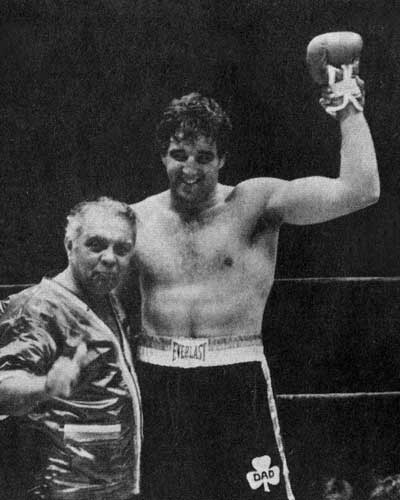Gerry Cooney, at right, with his trainer, Victor Valle.
