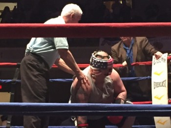 Referee Jack Morrell halts the contest moments after Luis Rivera stretched Anthony Sansevero (R) of Watertown, MA