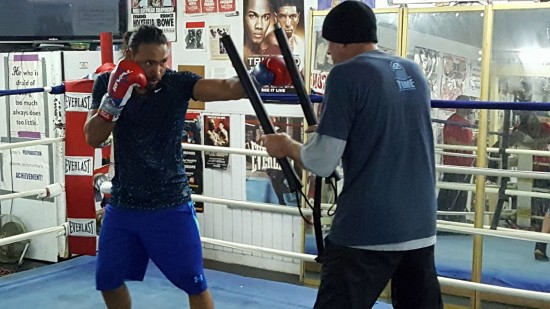 Keith Thurman, at left, works some drills with trainer Dan Birmingham.