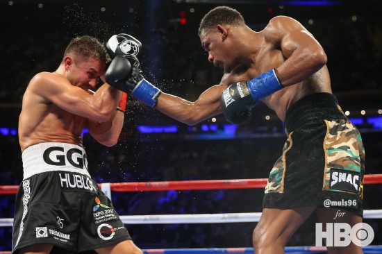 Daniel Jacobs, at right, attacks Golovkin (photo by Ed Mulholland/HBO)