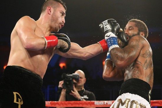 Lemieux, at left, lands a punishing left on Stevens (photo by Ed Mulholland/HBO Sports).