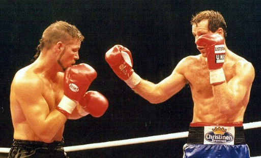 John Scully, seen here at left when he fought and lost a decision against then IBF Light Heavyweight World Champion Henry Maske in 1996.